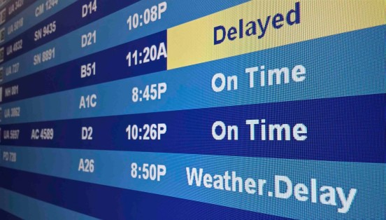 Flight information including delays are on display on a screen at the Washington Dulles Airport in Dulles